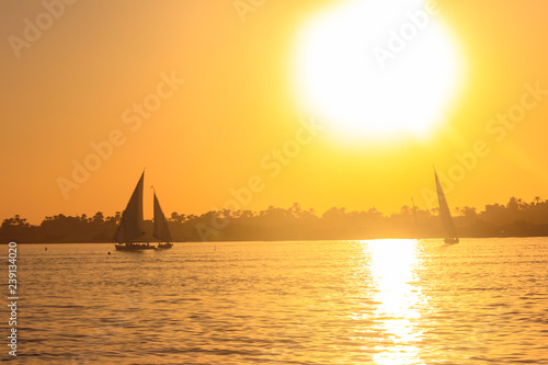 fototapeta na ścianę View of the Nile river with sailboats at sunset in Luxor, Egypt