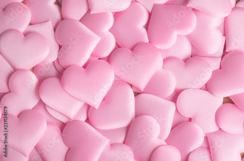 Valentine's Day. Pink heart shape backdrop. Abstract holiday Valentine background with pink satin hearts. Love concept. Flat lay, top view