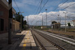 View down the track at Santa Severa train staion, near Rome, Italy - blue sky and clouds overhead