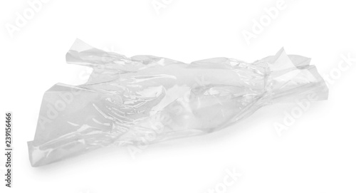 Foto op Aluminium Snoepjes Crumpled transparent candy wrapper on white background