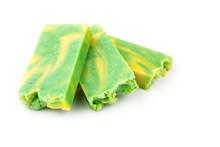 Handmade Green And Yellow Artisan Jojoba Soap Bars On White Background