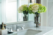 White And Green Flower Vase Decorate On Wash Basin In White Interior Restroom House Design