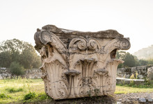 Close Up Of A Beautiful Corinthian Column In The Morning, Located And Preserved Among The Ruins In The Ancient Agora In Athens, Greece.