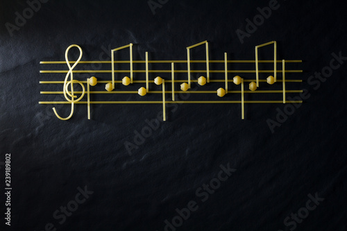 Fotografía  Musical Christmas sheet music paste isolated on a black textural background