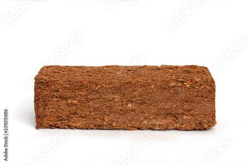 Block of Coconut Coir Husk Fiber isolated on white background