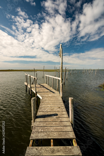 Fotografie, Obraz  Boat Dock on a small lake in New Jersey with clouds in the sky