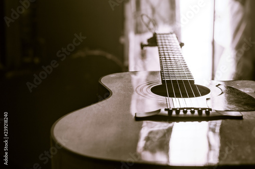acoustic guitar close-up on a beautiful colored background - 239218240