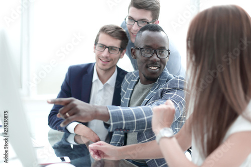 Fototapety, obrazy: multi-ethnic business team is discussing new information