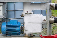 Electric Motor And Industrial Pump  Ice Covered   In Refrigeration Plant
