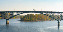 Ross Island Bridge In Portland, Oregon. Arc Shaped Cantilever Truss Bridge Across Willamette River; Connects East And West City Sides.