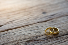 Two Gold Rings On Wooden