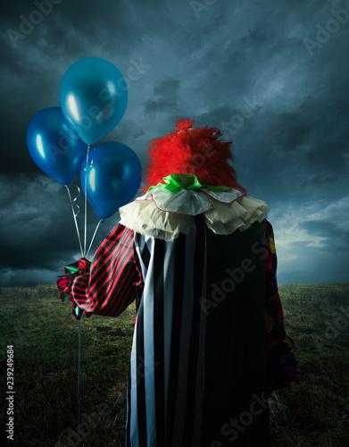 Ingelijste posters Halloween Scary clown on a field at night