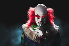 Scary Clown On A Dark Background