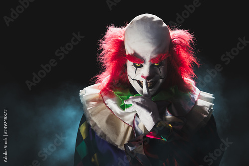 Foto Scary clown on a dark background