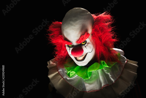 Tableau sur Toile Scary clown on a dark background