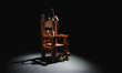 canvas print picture - Electric chair in a dark background