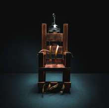 Electric Chair In A Dark Backg...
