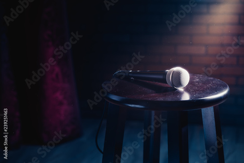Fotografie, Obraz  microphone on a wood stool on a stage