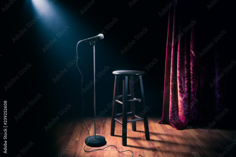 Fototapety, obrazy: microphone and wooden stool on a stand up comedy stage with reflectors ray, high contrast image