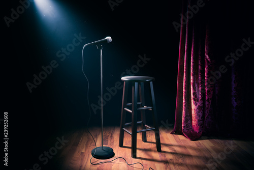 microphone and wooden stool on a stand up comedy stage with reflectors ray, high contrast image - 239252608