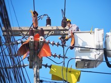 Electricians Are Repairing High-voltage Electricity On High, To Repair Defective Equipment, Which Causes Power Outage.