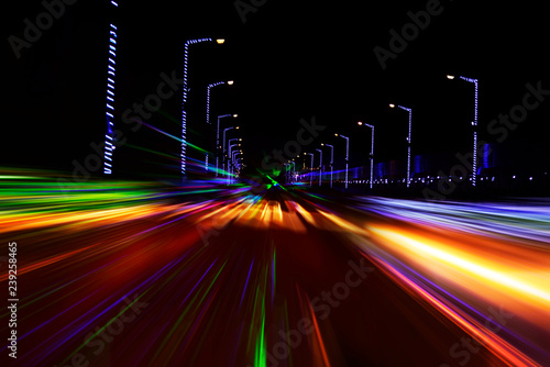 Car moving on highway against dark night, photograph is taken with long exposure Canvas Print