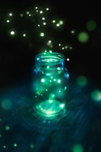 Fireflies In A Jar On A Dark Background