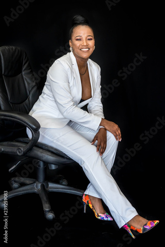 Garden Poster Martial arts African business woman in white suit