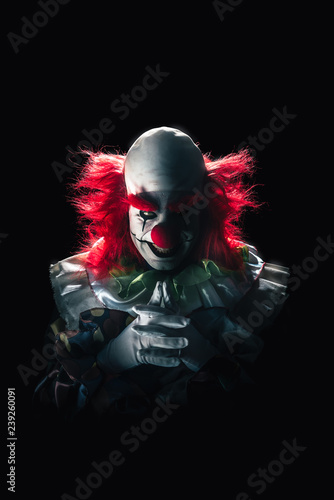 Fotomural Scary clown on a dark background