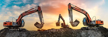 Three Excavators Work On Const...