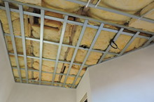 A Metal Frame Of A Ceiling Under Construction Insulated With Mineral Wool