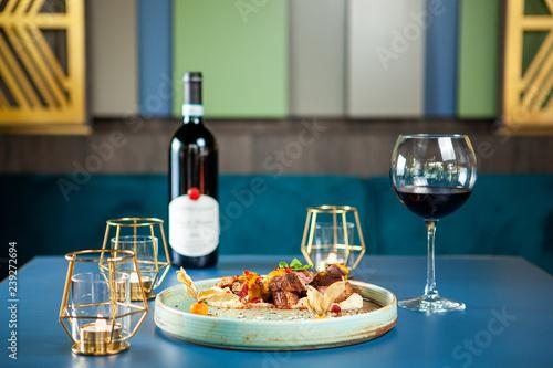 Spoed Foto op Canvas Klaar gerecht Tasty restaurant gastronomy with red wine on the table. Fine dining