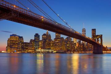 Brooklyn Bridge and New York City skyline at dusk