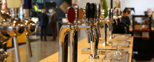 Beer Taps Lined Up On The Coun...
