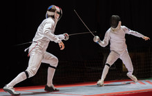 Two Man Fencing Athletes Fight