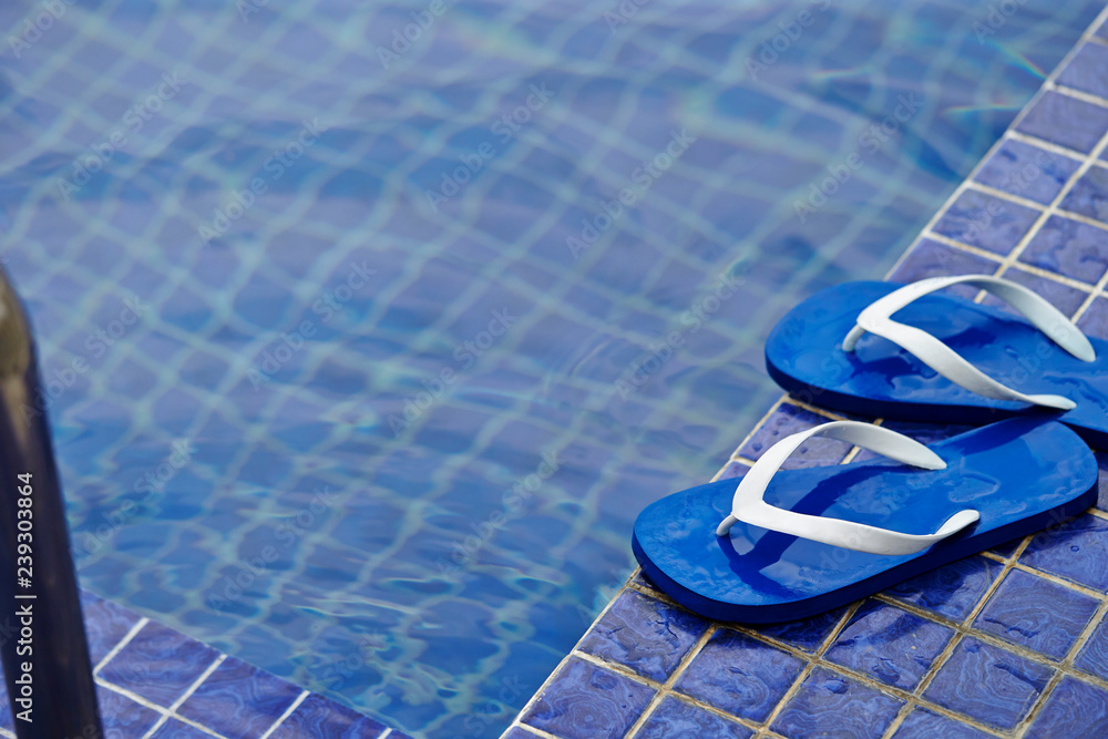 Fototapeta Flip flop at poolside