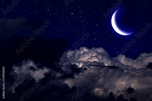 Wall Murals Night Evening crescent in the cloudy sky