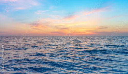 calmness seascape in colorful sunset sky