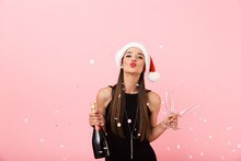 Cheerful Young Woman Wearing Christmas Hat