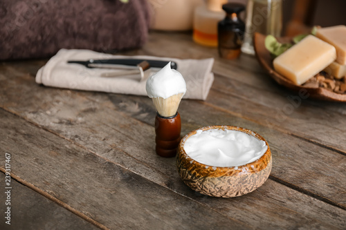 Poster Produit laitier Shaving brush and bowl with foam on wooden table