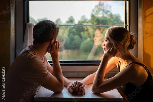 Fotografía Couple of lovers traveling in train