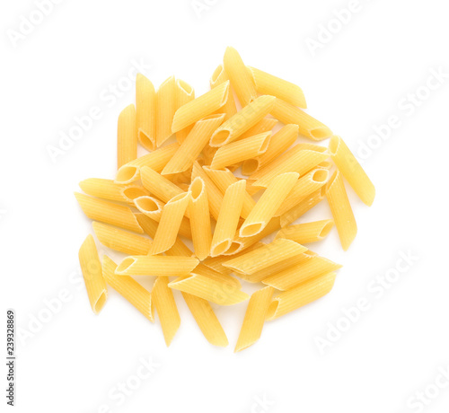Uncooked penne pasta on white background Fototapet