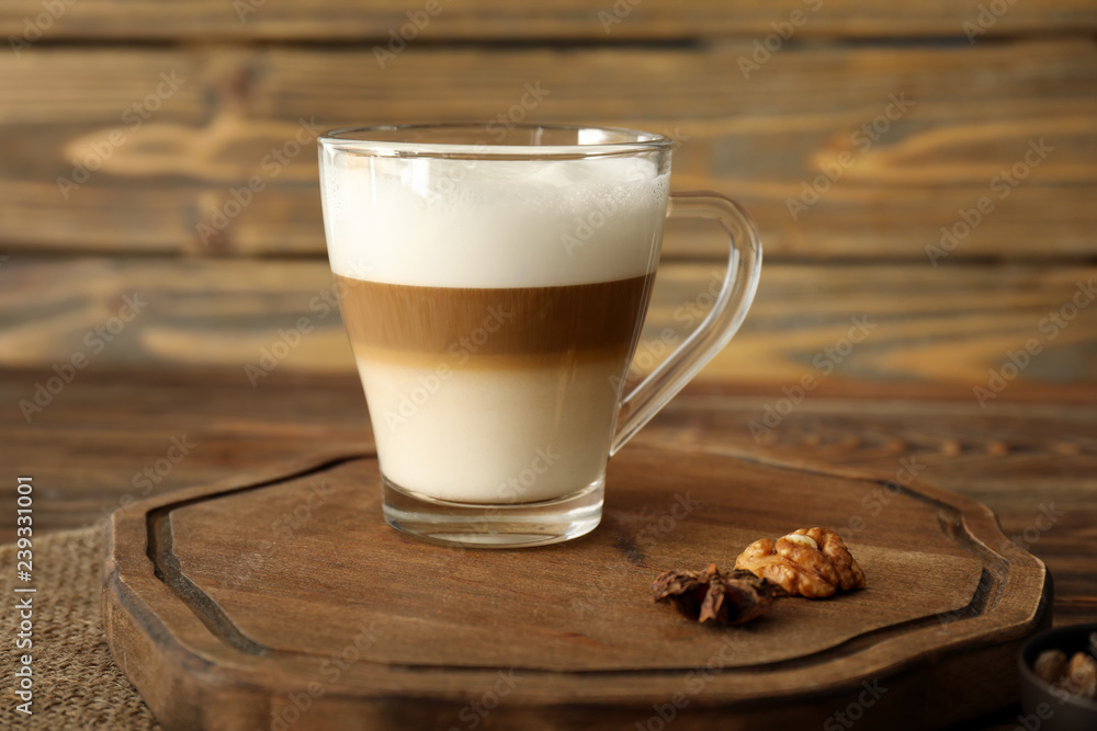 Fototapety, obrazy: Glass cup of tasty aromatic latte on wooden board