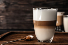 Glass Of Tasty Aromatic Latte On Wooden Board