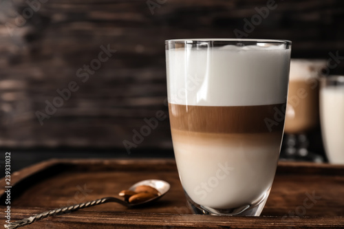 Glass of tasty aromatic latte on wooden board Billede på lærred