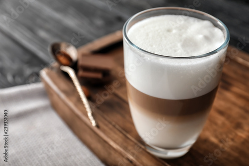 Glass of tasty aromatic latte on wooden board Tableau sur Toile