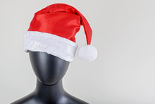 A Head Of Female Mannequin With Santa Claus Hat Isolated On White Background.