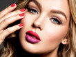canvas print picture Gorgeous woman with  curly beautiful hair. Makeup. Bright colored lips.