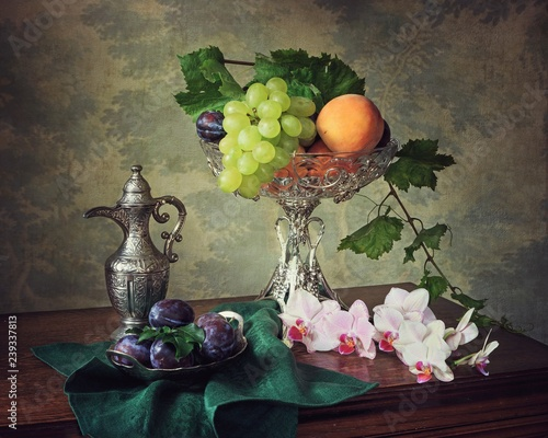 Fototapeta Still life with orchid branch and fruits obraz