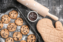 Tasty Cookies With Chocolate Chips On Wooden Table